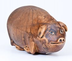 Rare and Fine Anna Pottery Stoneware Pig Flask, Wallace and Cornwall Kirkpatrick, Anna, IL, circa 1880. This example features a light Albany slip wash, and a crisply-incised map of the Midwest including the landmark