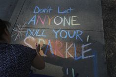 Andreas Fuhrmann/Record Searchlight Phylicia Snow, Development Director with the United Way participates Tuesday in Chalk the Walk with people from the Shasta County Child Abuse Prevention Council in front of their Redding building. Go to www.redding.com to read more.