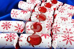 A close up of festive Christmas crackers decorated with bright red robins