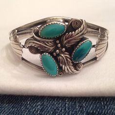 Wide Navajo vintage cuff with oval turquoise nestled in cactus flower, a beautiful boho southwest accessory!