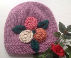 knitted baby beanie hat with large knitted flowers, Easter , spring, new baby gift by Angelasknittingtree on Etsy https://www.etsy.com/listing/201294054/knitted-baby-beanie-hat-with-large
