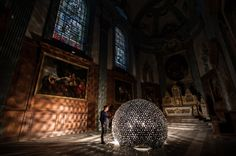 Lotus Dome by artist Daan Roosegaarde, exhibited in the Rijksmuseum, Amsterdam. The Lotus Dome is a 'living' dome made out of hundreds of ultra-light mylar leafs which open when they are touched. https://www.rijksmuseum.nl/en/whats-on/news/daan-roosegaardes-luminous-work-of-art-in-the-rijksmuseum