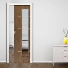 Single Pocket Eco Mocha Walnut sliding door system in three size widths with clear glass. #glazedwalnutpocketdoor #internalglazedslidingdoor #internalglazedpocketdoor