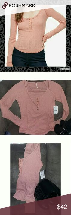 Free People Fitted Henley free people fitted Henley. Size large. New with tags. Cotton polyester blend. Light breathable material. Scoop neckline.  The color says red on tag but it is more of a faded red. Free People Tops