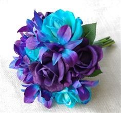 Bouquet made with Natural Touch Purple and Teal Roses mixed with Two Tone Purple Blue Mokara Orchids.