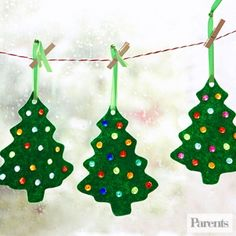 Trace a cookie cutter onto felt, then punch multiple holes. Glue plastic beads over holes and hang in a window -- or on your tree.