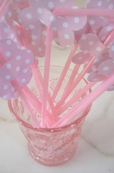 these are just flowers shapes punched out of scrapbook paper and slipped onto pink straws.