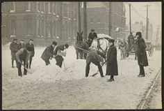 Clearing the road of snow in 1910, near E. 9th and Superior