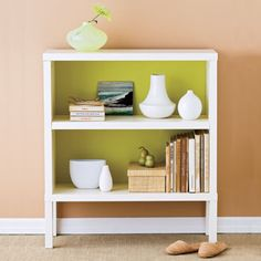 """Take a basic bookshelf from """"blah"""" to """"aha"""" with this quick fix: Paint the case's back wall in a cheery, contrasting hue."""