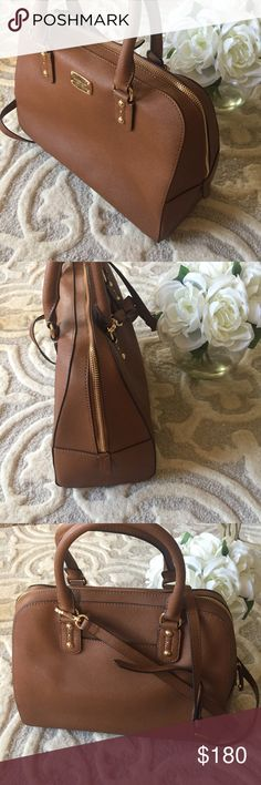 NWOT Michael Kors large saffiano satchel brown NWOT Michael Kors large brown saffiano Leather satchel. Original tag included with care instructions- tag wash it's taken off. Never worn or used Michael Kors Bags Satchels