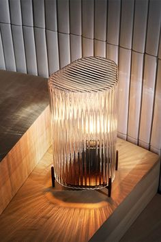 """IITTALA PUTKI TABLE LAMP Finnish for """"tube,"""" Putki is a cylindrical lamp made by master glassblower Matti Klenell in 2018 for Sweden's National Museum. It is both eye-catching and subdued, with a warm copper glow thanks to the rippled, colored glass. The lamps can be used on the floor, on a table, or windowsill"""