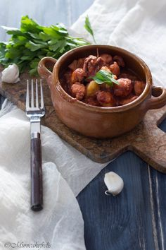 Tentacoli di totano con pomodoro e patate