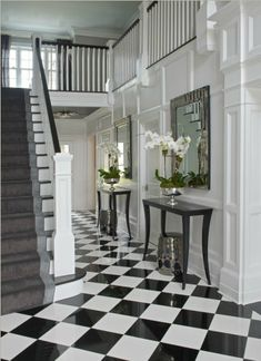 Black and white checkered marble floor in hallway | Susan Glick