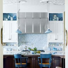 So many gorgeous details in this amazing kitchen: the open shelves mixed into the cabinetry the moulded ceiling the bright patterned backsplash the mercury glass pendants. Tell us your favorite part!  Featured in @housebeautiful. Photo by @francescolagnese. Design by Martin Horner of @souciehorner. #kathykuohome #interiordesign #kitchen #color by kathykuohome