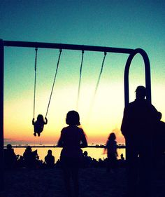Frankfort: sunset over lake Michigan. I remember these swings...