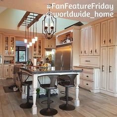 A simply STUNNING #FanFeatureFriday pic today! The owner of this gorgeous kitchen didn't want us to publish his name, but we begged, and he relented to let us share the picture. The Astra adjustable kitchen stools from !nspire add a contemporary touch to this elegant kitchen design...     http://worldwidehomefurnishingsinc.com/astra-adjustable-stool-in-gunmetal.html