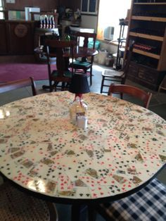 Took playing cards, glued them to a table and sealed the table with Epoxy for durability. Great for a Gaming Room or Rec Room :-)