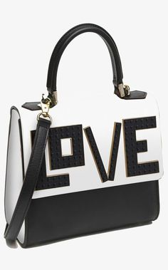 All you need is love-even better if it's on a handbag with a classic color combo and the label's signature Lego accents.