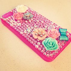 Swarovski crystal iPhone 5 case in pink. Covered in jewels, bows and pearls. #icedaddiction #etsy