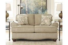 Extra roomy and loaded with stylish possibilities. Alma Bay loveseat impresses in every way. Plush, richly textured chenille upholstery, rolled arms and a uniquely curved apron bring a softer element. Nailhead trim delivers a ruggedly handsome punch.