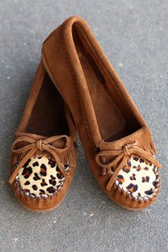 Every girl needs at least one good pair of Minnetonka moccasins in her wardrobe. These feature supple suede and hair-on leather plug in leopard print with a sporty rubber sole. Dusty brown in color. I