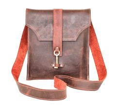Leather Messenger Bag with Skeleton Key Antique Hardware  This rich burgundy oiled leather envelope style messenger bag features industrial strength leather-grade nylon double stitching,silver hardware and an antique skeleton key as a closure. This messenger is roomy and perfect for carrying your essentials – whatever they may be. Each order has a different, unique key. The bag even features a hidden rear pocket, perfect for your phone! Over time the leather will develop a beautiful patina…