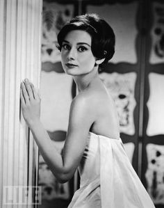 Over-the-Shoulder Audrey  Audrey Hepburn looks back in the early 1950s.