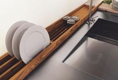 Clever idea for dish drying. And we have all that space behind the sink . . . not sure I could reach it, though.