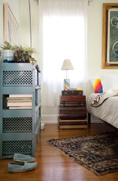 stacked suitcases nightstand