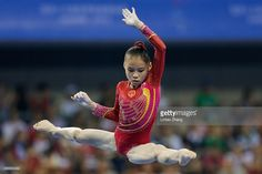 Shang Chunsong of China performs on the uneven bars during the Women's Team Final on day two of the 45th Artistic Gymnastics World Championships at Guangxi Sports Center Stadium on October 8, 2014 in Nanning, China.