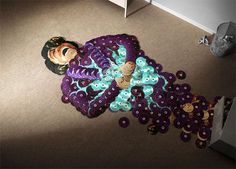 James Brown portrait made from his own CDs... Italian artists Mirco Pagano and Moreno De Turco created this advertising campaign featuring dead bodies of famous singers created out of their CDs. The campaign calls attention to Internet piracy, which has brought the music industry to its knees.
