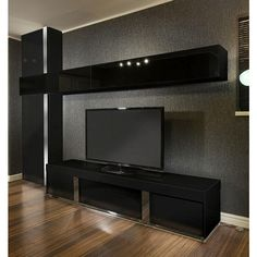Large TV stand plus wall mounted storage cabinet black glass black gloss. Features include beautiful design, 2 vertical black gloss cabinets and two black glass fronted horizontal cabinets with upward opening pistons. All cabinets come assembled except for the handles. Professional concealed wall fittings enable simple levelling after the unit has been hung. Call 02476 642139 or email sales@quatropi.com or visit www.quatropi.com for additional information.