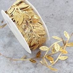 Looking for wedding ribbon or gold wedding decorations? Check out this gorgeous metallic gold ribbon in the shape of faux leaves. This unique metallic gold leaf ribbon with distinct texture detail is