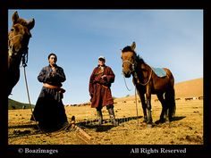 Mongolian nomads on their horses.  Photo taken in Central Mongolia.