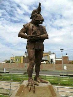 Estátua reptiliana de Morrop no Peru. Em histórias, os homens iguanas viviam no subsolo e eram mediadores entre o mundo dos vivos e o mundo dos mortos.