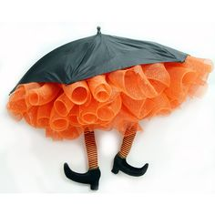 •❈• A pair of orange & black striped Witch Legs (pool noodles from DS will work) transform an inexpensive black umbrella into a precious Halloween decoration. So inexpensive make several and hang from the ceiling. Beware of Witch! http://www.mardigrasoutlet.com/catalog/6764.html