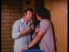 Kevin Tighe and Randolph Mantooth as Roy and John in fire station locker room.