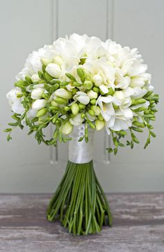 No 4. All white Freesia bouquet to give you an idea of the shape of posy that I had in mind. A lilac and white Freesia bouquet in this style would look lovely and maybe with the stems more covered with the ribbon.