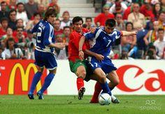 Greece 2 Portugal 1 in 2004 in Porto. Luis Figo challenges Theo Zagorakis in Group A at Euro 2004.