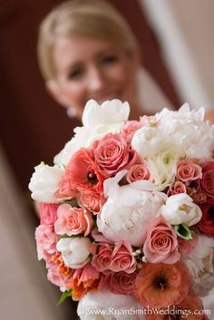 coral roses, poppies and parrot tulips with white peonies, tulips, and ranunculus