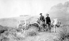 DAVID RUST(L) WITH COMPANION & 2 BURROS POSE BY TRAMWAY SIGN ON TONTO PLATEAU. CIRCA 1910. RUST COLLECTION. Grand Canyon National Park. Courtesy:  National Park Service (USA).