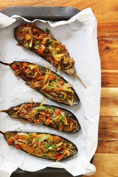 İmam Bayıldı (Stuffed Eggplant Boats): Turkish classic that's lighter, cooks quicker and has no refined sugar. Recipe by Olga Irez of Delicious Istanbul