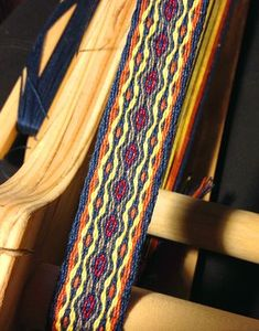 This tablet woven band was based on a draft by Silvia Dominguez. More of my weaving can be seen on http://weaverly.typepad.com