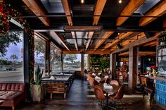 Exposed Wood Beams. Electric Patio heater. Love the chairs. Benches as booth seating.  Posted by Mel.