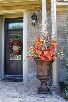 Using corkscrew willow branches to add height to the planters. Can easily be left in for Christmas decor, too. #Fall