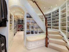 enchanted-lace:    omg look at all the shoes..    Are those stairs that lead to a walk-in closet. WOW!