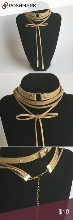 Tan layered choker necklace set Layered Choker Necklace set. Light tan with gold glitter. *Faux leather *2 necklaces *Adjustable *Snap  *Lengths range from approximately 15 1/2 inches to 17 inches *Brand new Jewelry Necklaces