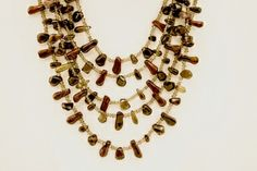 Smokey Quartz Red Tiger Eye Necklace with sterling silver decorative cap closure.