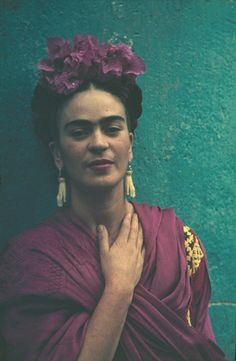 * Frida Kahlo ca 1940  with earrings ivory hand given to Kahlo by Picasso when she visited Paris photo Nickolas Muray  (1892-1965)