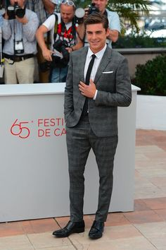 Zac Efron looks like I could snap his leg in half. Eat a sandwich! (Nice suit though...)